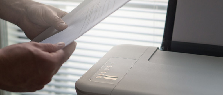 printers for graphic designer: man printing documents
