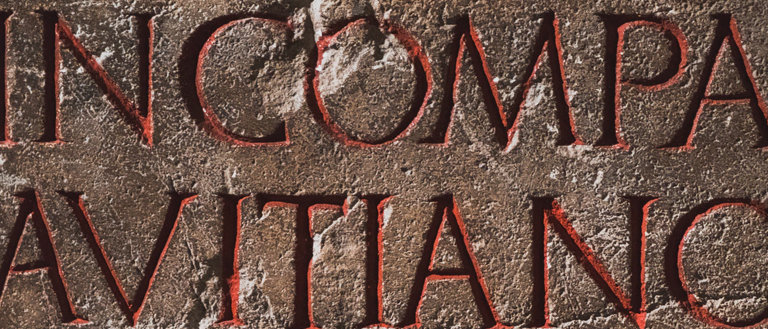 letters chiselled into a stone