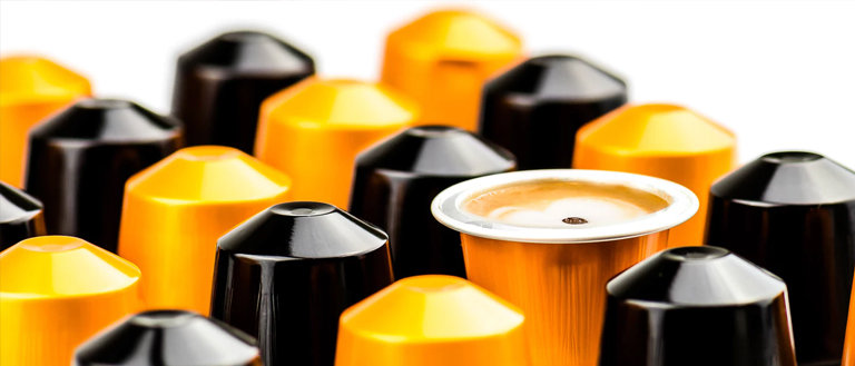 black and gold coffee capsules