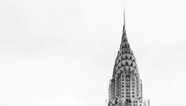top of chrysler building in black and white