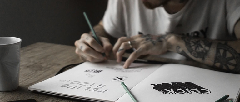 freelancer drawing a logo in his notebook