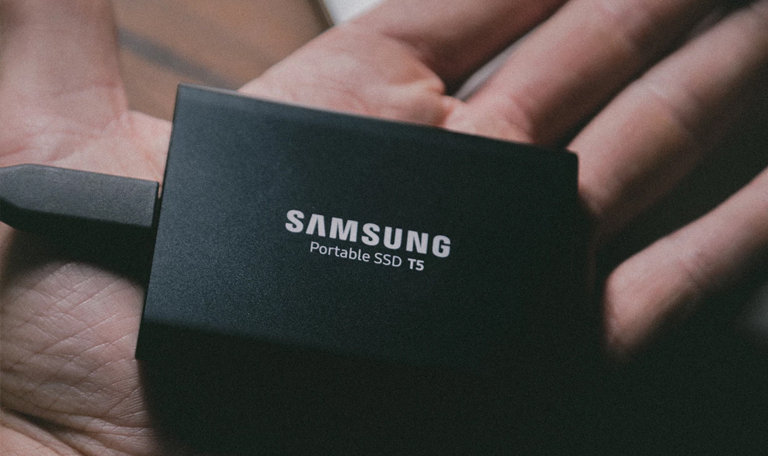 samsung portable ssd disk in persons hand