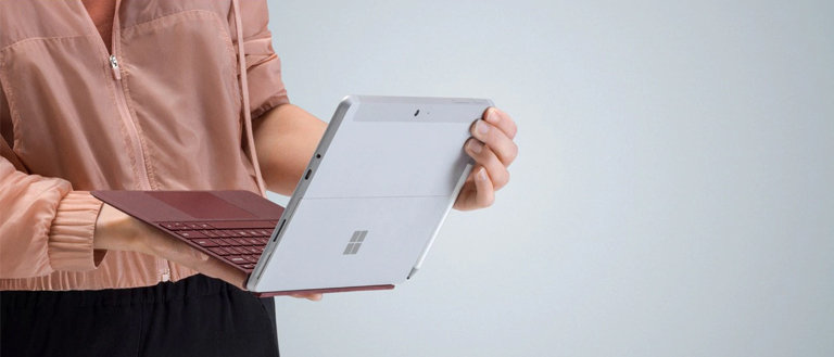 person holding microsoft surface go